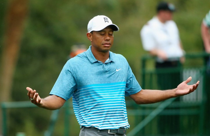 tiger_woods_2015_masters_practice_shrug